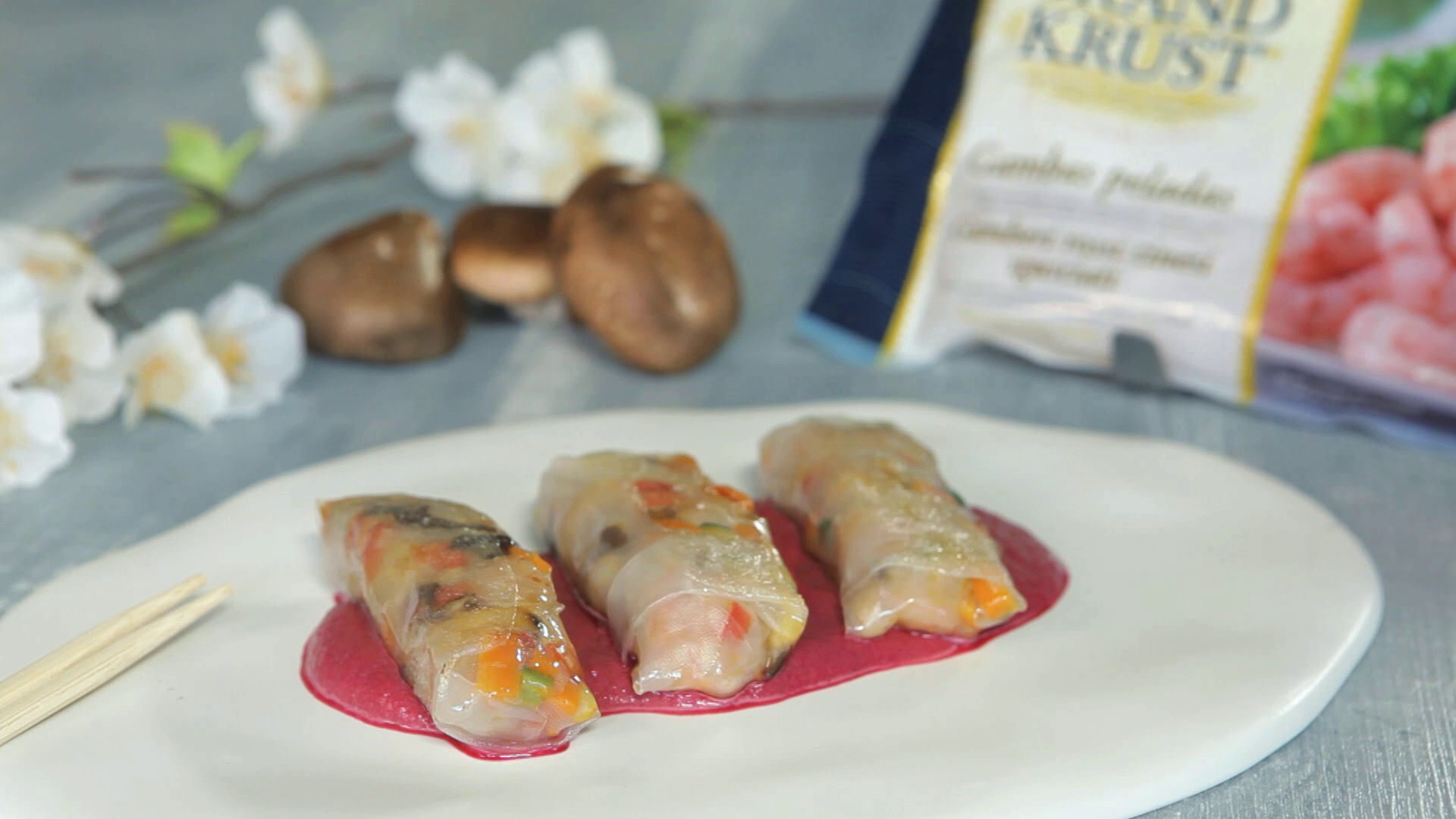 Vietnamese spring rolls with red beet sauce